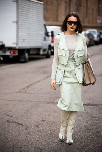 MILAN, ITALY - FEBRUARY 20: Mary Leest, wearing a grey top, light green vest with matching skirt, cream boots and taupe bag, is seen outside Max Mara show, during Milan Fashion Week Fall/Winter 2020-2021 on February 20, 2020 in Milan, Italy. (Photo by Claudio Lavenia/Getty Images)
