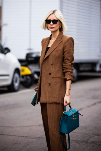 MILAN, ITALY - FEBRUARY 20: Lisa Hahnbueck, wearing a brown striped suit and blue bag, is seen outside Max Mara show, during Milan Fashion Week Fall/Winter 2020-2021 on February 20, 2020 in Milan, Italy. (Photo by Claudio Lavenia/Getty Images)
