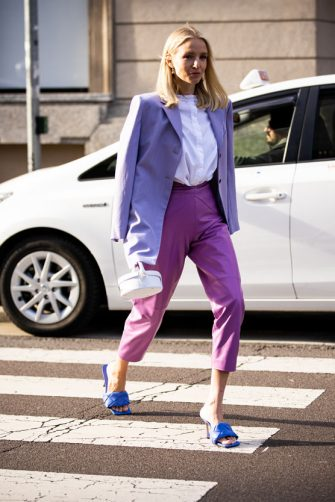 MILAN, ITALY - FEBRUARY 20: Leonie Hanne, wearing a white shirt, lilac blazer, purple leather pants, blue Bottega Veneta sandals and white Jacquemus bag, is seen outside Max Mara show, during Milan Fashion Week Fall/Winter 2020-2021 on February 20, 2020 in Milan, Italy. (Photo by Claudio Lavenia/Getty Images)