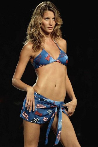 SAO PAULO, BRAZIL:  Brazilian model Gisele Bundchen displays a swimsuit for Cia Maritima on 03 July 2001 as part of the Spring-Summer collection in Sao Paulo, Brazil. AFP PHOTO/Mauricio LIMA (Photo credit should read MAURICIO LIMA/AFP via Getty Images)