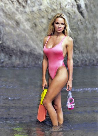 Actress Pamela Anderson wearing swimsuit on Catalina Island,California during filming of TV series Baywatch in October 1992.