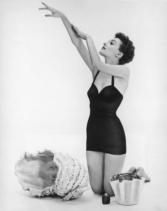 Actress Donna Wallace applies sun tan lotion before a day on the beach, circa 1950. (Photo by Keystone/Hulton Archive/Getty Images)