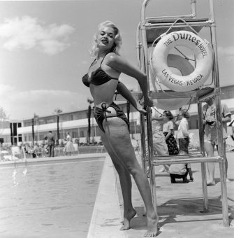 American film actor and sex symbol Jayne Mansfield (1933 - 1967) poses in a bikini by a lifeguard chair at the Dunes Hotel, Las Vegas, Nevada, mid 1950's. (Photo by Hulton Archive/Getty Images)