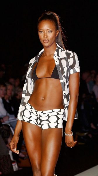 LONDON, ENGLAND - SEPTEMBER 24:  Model Naomi Campbell walks the runway at the Jasper Conran fashion show for London Fashion Week held at the BFC Tent on Kings Road September 24, 2003 in London, England.  (Photo by Steve Finn/Getty Images)