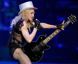 "LAS VEGAS - NOVEMBER 08:  Singer Madonna performs at the MGM Grand Garden Arena November 8, 2008 in Las Vegas, Nevada. Madonna's Sticky & Sweet Tour is in support of her latest album, ""Hard Candy.""  (Photo by Ethan Miller/Getty Images)"