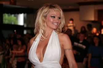 WASHINGTON - APRIL 26:  Pamela Anderson arrives at the White House Correspondents' Association dinner on April 26, 2008 in Washington, DC. (Photo by Nancy Ostertag/Getty Images)