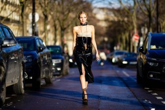 PARIS, FRANCE - FEBRUARY 29: Leonie Hanne wears a scarf, a black shiny off-shoulder leather dress, a mini Vuitton cylinder shaped bag, outside Rokh, during Paris Fashion Week - Womenswear Fall/Winter 2020/2021, on February 29, 2020 in Paris, France. (Photo by Edward Berthelot/Getty Images)