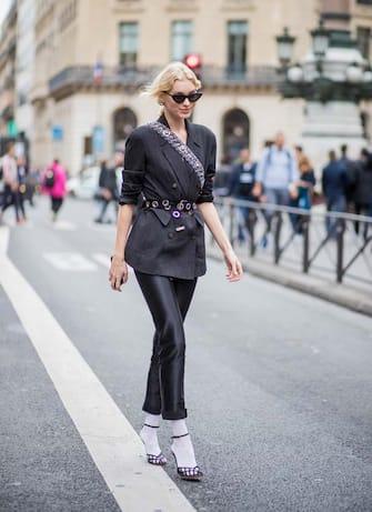PARIS, FRANCE - SEPTEMBER 28: Model Elsa Hosk wearing blazer, cropped pants, white socks, heels is seen outside Balmain during Paris Fashion Week Spring/Summer 2018 on September 28, 2017 in Paris, France. (Photo by Christian Vierig/Getty Images)
