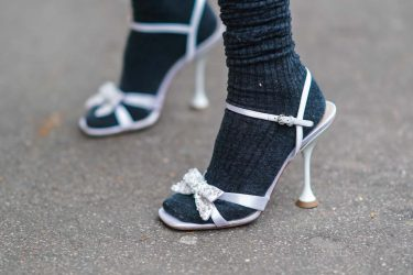 PARIS, FRANCE - JANUARY 21: Natalia Verza aka Mascarada wears a total Miu Miu look made of black long wool socks, high heeled shoes with bow tie details, on January 21, 2021 in Paris, France. (Photo by Edward Berthelot/Getty Images)