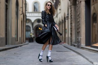 FLORENCE, ITALY - JANUARY 12: German fashion blogger and model Alexandra Lapp wearing white Mother Fucker knit socks with a vintage inspired, tube style and bold lettering by Mother Denim, plateau sandals in racing green from Prada, shirt dress in black calfskin leather by SET, handmade clutch, matte black 'Dior So Real' sunglasses from Dior Eyewear on January 12, 2017 in Florence, Italy. (Photo by Christian Vierig/Getty Images)