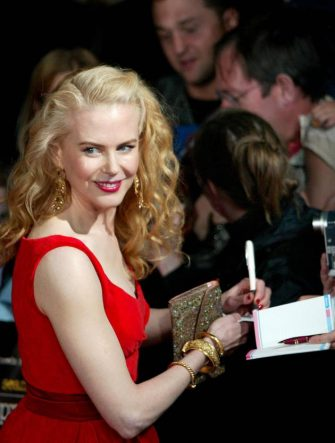 """SYDNEY, AUSTRALIA:  Actress Nicole Kidman signs autographs at the Sydney Opera House, 04 April 2005 after she arrived to attend the world premiere of """"The Interpreter"""".  Australia is hosting the world premiere of """"The Interpreter"""", which opens nationa-wide 14 April, ahead of its release in the US  22 April and the UK 15 April.  Kidman will also attend premieres of the film in Berlin on 13 April, London 14 April, and New York 19 April.  AFP PHOTO/Rob ELLIOTT  (Photo credit should read ROB ELLIOTT/AFP via Getty Images)"""