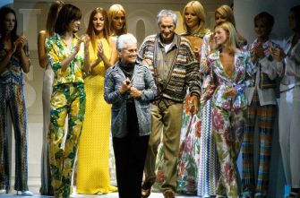 MILAN, ITALY - OCTOBER 01: Italian fashion designer Ottavio Missoni and wife Rosita acknowledge the applause of the audience after Missoni fashion show Spring-Summer 1996, on October 01, 1995 in Milan, Italy. Ottavio Missoni celebrated his ninetieth birthday on February 11, 2011. (Photo by Enzo Signorelli/Getty Images)