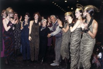The fashion designer Ottavio Missoni and his wife Rosita Missoni (Rosita Jelmini) smile on the catwalk at the end of a fashion show, surrounded by various models applauding. Italy, 1984. (Photo by Angelo Deligio/Mondadori via Getty Images)