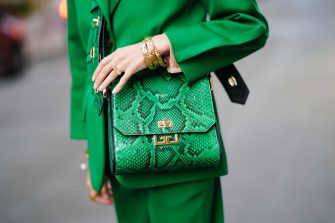 PARIS, FRANCE - OCTOBER 15: Leonie Hanne wears a green blazer jacket, a green leather Givenchy bag with printed snake pattern, green pants, golden bracelets, in the streets of Paris, on October 15, 2019 in Paris, France. (Photo by Edward Berthelot/Getty Images)