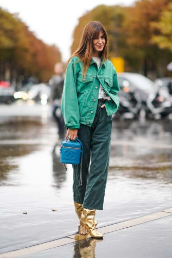PARIS, FRANCE - OCTOBER 01: Gala Gonzalez wears a green denim jacket, a white top, green pants, golden boots, a blue Chanel bag, outside Chanel, during Paris Fashion Week - Womenswear Spring Summer 2020, on October 01, 2019 in Paris, France. (Photo by Edward Berthelot/Getty Images)