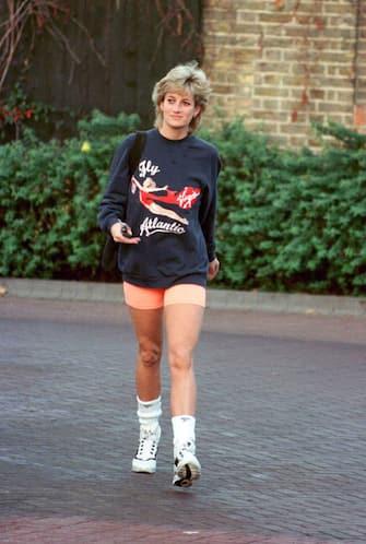 LONDON - NOVEMBER 1995:  Princess Diana, Princess of Wales, wearing  Virgin Atlantic sweatshirt, leaves Chelsea Harbour Club, London in November, 1995.  (Photo by Anwar Hussein/WireImage)
