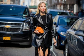 NEW YORK, NEW YORK - FEBRUARY 09: Leonie Hanne is seen wearing orange Bottega micro bag, black varnished jacket, dress with fringes and slits outside Bevza during New York Fashion Week Fall / Winter on February 09, 2020 in New York City. (Photo by Christian Vierig/Getty Images)
