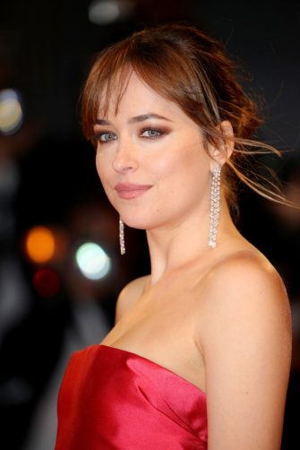 VENICE, ITALY - SEPTEMBER 01:  Dakota Johnson walks the red carpet ahead of the 'Suspiria' screening during the 75th Venice Film Festival at Sala Grande on September 1, 2018 in Venice, Italy.  (Photo by Andreas Rentz/Getty Images)
