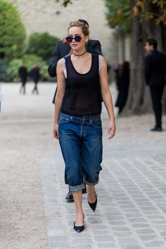 PARIS, FRANCE - SEPTEMBER 30: Actress Jennifer Lawrence wears a sheer top, cropped denim jeans and pointed flats outside of Dior on September 30, 2016 in Paris, France. (Photo by Christian Vierig/Getty Images)