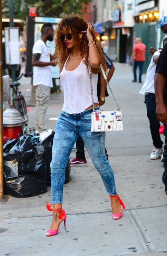 NEW YORK, NY - AUGUST 12:  Singer Rihanna is seen coming out of Coppelia restaurant in Soho on August 12, 2015 in New York City.  (Photo by Raymond Hall/GC Images)