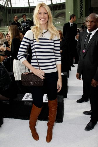 PARIS - OCTOBER 05: Claudia Schiffer attends the Chanel Ready to Wear Spring/Summer 2011 show during Paris Fashion Week at Grand Palais on October 5, 2010 in Paris, France. (Photo by Michel Dufour/WireImage)