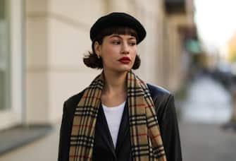 BERLIN, GERMANY - NOVEMBER 05: Lea Naumann wearing vintage black coat, Burberry scarf, H&M hat on November 05, 2020 in Berlin, Germany. (Photo by Jeremy Moeller/Getty Images)