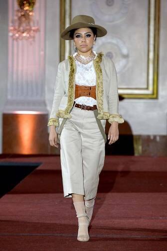 NEW YORK, NEW YORK - FEBRUARY 14: A model walks the runway for the NYFW hiTechMODA Spotlight on the New Era of Fashion - Curious Clothier: Collection - Dakota's NYC Debut on February 14, 2021 in New York City. (Photo by Noam Galai/Getty Images for NYFW hiTechMODA )