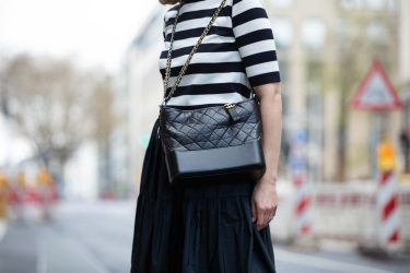 DUSSELDORF, GERMANY - APRIL 15: Patricia Wirschke, Fashion Blogger, art historian and ceo of high10art is seen wearing Les Copains Stipes Shirt in Navy white, Les Copains Popelin maxi Skirt in Navy, Chanel Gabrielle Bag with Chains in Black, on April 15, 2021 in Dusseldorf, Germany. (Photo by Mathis Wienand/Getty Images)