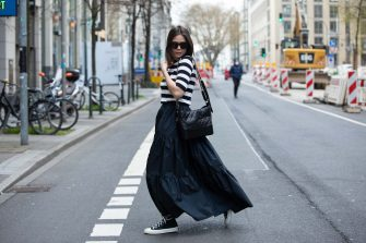 DUSSELDORF, GERMANY - APRIL 15: Patricia Wirschke, Fashion Blogger, art historian and ceo of high10art is seen wearing Les Copains Stipes Shirt in Navy white, Les Copains Popelin maxi Skirt in Navy, Converse Chucks in black, Chanel Gabrielle Bag with Chains in Black, YSL Black Sunglasses on April 15, 2021 in Dusseldorf, Germany. (Photo by Mathis Wienand/Getty Images)