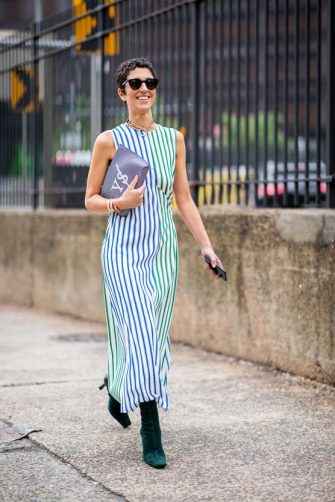 NEW YORK, NY - SEPTEMBER 11: Yasmin Sewell wearing striped sleeveless dress, clutch is seen outside Oscar de la Renta during New York Fashion Week Spring/Summer 2019 on September 11, 2018 in New York City. (Photo by Christian Vierig/Getty Images)