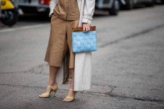 MILAN, ITALY - FEBRUARY 20: Linda Tol is seen wearing trench coat, brown shorts, button shirt, blue clutch outside Max Mara during Milan Fashion Week Fall/Winter 2020-2021 on February 20, 2020 in Milan, Italy. (Photo by Christian Vierig/Getty Images)