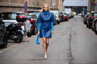 MILAN, ITALY - FEBRUARY 21: Leonie Hanne is seen wearing blue turtleneck, blue dress, Prada bag outside Sportmax during Milan Fashion Week Fall/Winter 2020-2021 on February 21, 2020 in Milan, Italy. (Photo by Christian Vierig/Getty Images)