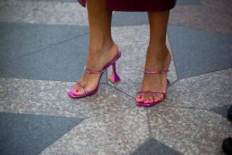 COPENHAGEN, DENMARK - AUGUST 11: Elizabeth Delphine outside Rains wearing pink summer shoes during Copenhagen fashion week SS21 on August 11, 2020 in Copenhagen, Denmark. (Photo by Raimonda Kulikauskiene/Getty Images)
