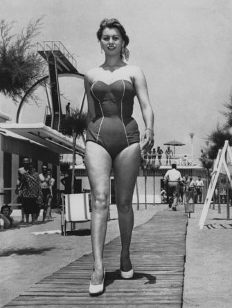 Italian actress Sophia Loren wearing a one-piece swimsuit to the beach, circa 1956. (Photo by Keystone/Hulton Archive/Getty Images)