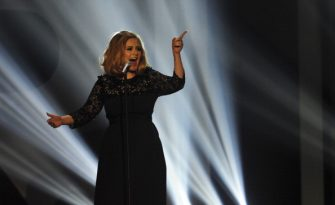 British singer-songwriter Adele performs on stage at the BRIT Awards 2012 in London on February 21, 2012.  AFP PHOTO / LEON NEAL (Photo credit should read LEON NEAL/AFP via Getty Images)