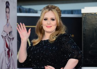 Singer Adele arrives on the red carpet for the 85th Annual Academy Awards on February 24, 2013 in Hollywood, California. AFP PHOTO/FREDERIC J. BROWN        (Photo credit should read FREDERIC J. BROWN/AFP via Getty Images)