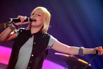 """MILAN, ITALY - APRIL 03:  Emma Marrone performs on the """"Top of the Pops"""" television show  on April 3, 2010 in Milan, Italy.  (Photo by Morena Brengola/Getty Images)"""