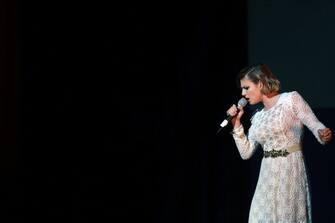 VENICE, ITALY - MARCH 01:  Italian singer Emma Marrone performs on stage during the Gran Ballo della Cavalchina at La Fenice Theatre on March 1, 2014 in Venice, Italy.  (Photo by Barbara Zanon/Getty Images)