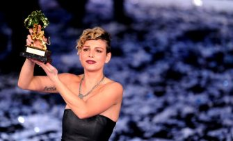 Italian singer Emma poses with her prize at the Ariston Theatre in Sanremo on February 18,2012 at the 62nd Italian Music Festival in Sanremo.   AFP PHOTO/ Tiziana Fabi (Photo credit should read TIZIANA FABI/AFP via Getty Images)