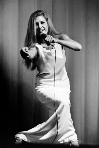 French singer Dalida performs 24 November 1971 at Olympia music-hall in Paris. Dalida (born Yolande Christina Gigliotti, 17 January 1933  03 May 1987) was an Egyptian-born singer, of Italian origin, making her career in France. She received 55 golden records and was the first songstress to get a diamond disc. Born of Italian parents in Shoubra, a district of Cairo, Egypt, she was the child of an opera violinist and was given singing lessons at an early age. In 1954 she won the Miss Egypt beauty contest and immediately left for Paris, France, to pursue a career in motion pictures. AFP PHOTO (Photo by - / AFP)        (Photo credit should read -/AFP via Getty Images)