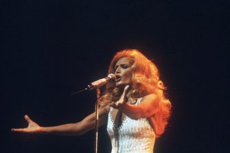 French singer Dalida performs 18 March 1981 at Olympia music-hall in Paris. Dalida (born Yolande Christina Gigliotti, 17 January 1933 â   03 May 1987) was an Egyptian-born singer, of Italian origin, making her career in France. She received 55 golden records and was the first songstress to get a diamond disc. Born of Italian parents in Shoubra, a district of Cairo, Egypt, she was the child of an opera violinist and was given singing lessons at an early age. In 1954 she won the Miss Egypt beauty contest and immediately left for Paris, France, to pursue a career in motion pictures. AFP PHOTO DOMINIQUE FAGET (Photo credit should read DOMINIQUE FAGET/AFP via Getty Images)