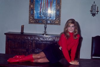 Dalida; a singer; on a table posing for the photo; circa 1970; New York. (Photo by Art Zelin/Getty Images)