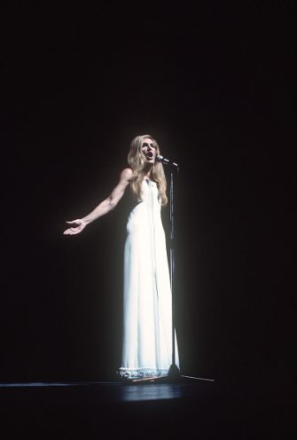 French singer Dalida performs in January 1974 at Olympia music-hall in Paris. Dalida (born Yolande Christina Gigliotti, 17 January 1933  03 May 1987) was an Egyptian-born singer, of Italian origin, making her career in France. She received 55 golden records and was the first songstress to get a diamond disc. Born of Italian parents in Shoubra, a district of Cairo, Egypt, she was the child of an opera violinist and was given singing lessons at an early age. In 1954 she won the Miss Egypt beauty contest and immediately left for Paris, France, to pursue a career in motion pictures. AFP PHOTO (Photo by - / AFP) (Photo by -/AFP via Getty Images)