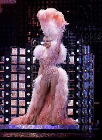 SYDNEY, AUSTRALIA - NOVEMBER 11:   Singer Kylie Minogue performs on stage for the opening night of her Showgirl Homecoming Tour at the Sydney Entertainment Centre on November 11, 2006 in Sydney, Australia. On May 17, 2005, 2 days before the Australian leg of her Showgirl Tour, Kylie's breast cancer diagnosis was announced to the world, and she consequently postponed her Australian tour dates. Now recovered, the tour has been renamed the Showgirl Homecoming Tour and Kylie returned to the stage for the first time.   (Photo by Getty Images)