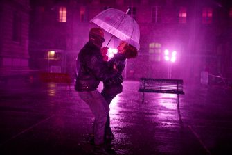 PARIS, FRANCE - AUGUST 02: Visitors dance at the 'Purple Rain' installation at the Lycée Jacques-Decour on August 02, 2020 in Paris, France. Part of Festival Paris l'Eté, the installation by Pierre Ardouvin is a tribute to the song by Prince and allows visitors to role play while equipped with umbrellas and accompanied by the song. (Photo by Kiran Ridley/Getty Images)