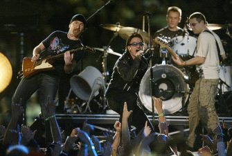 400517 11: Music group U2 performs during halftime of Super Bowl XXXVI February 3, 2002 at the Superdome in New Orleans, LA. Super Bowl XXXVI is being played by the New England Patriots and the St. Louis Rams. (Photo by Jed Jacobsohn/Getty Images)