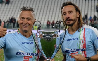 TURIN, ITALY - MAY 27: Paolo Belli (l) and Bob Sinclar (r) of Nazionale Italiana Cantanti with the trophy during the 'Partita Del Cuore' Charity Match at Allianz Stadium on May 27, 2019 in Turin, Italy. (Photo by Chris Ricco/Getty Images)