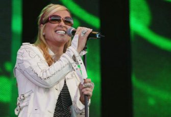 "LONDON - JULY 11:  Singer Anastacia performs on stage at ""95.8 Capital FM's Party In The Park For The Prince's Trust"" on July 11, 2004 at Hyde Park, in London. (Photo by Getty Images)"