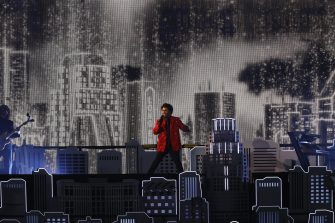 epa08995090 Canadian singer The Weeknd performs during the Halftime Show at the National Football League Super Bowl LV at Raymond James Stadium in Tampa, Florida, USA, 07 February 2021.  EPA/ERIK S. LESSER