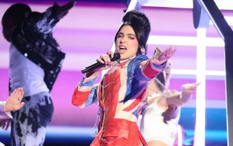 epa09192319 epa09192281 A handout photo made available by the Brit Awards shows Dua Lipa performing at the Brit Awards 2021 at the O2 Arena in Greenwich, Greater London, Britain, 11 May 2021. It is the 41st edition of the British Phonographic Industry's annual pop music awards.  EPA/JOHN MARSHALL / HANDOUT NO TV / NO USE AFTER 08 JUNE 2021 / MANDATORY CREDIT: JOHN MARSHALL HANDOUT EDITORIAL USE ONLY/NO SALES/NO ARCHIVES